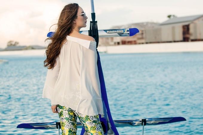 Hoa hậu Ngọc Diễm khoe vai trần chụp ảnh ở Thái Lan - 5